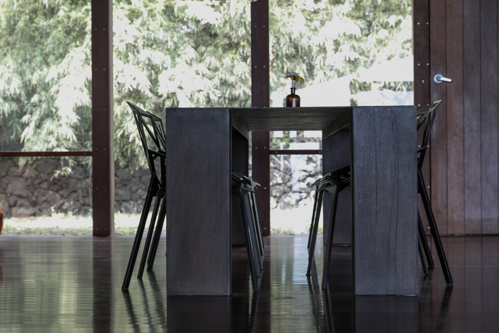 Dining Room, Chair, Table, and Dark Hardwood Floor  The Clifftop House by Modern on Maui - Liam Ball
