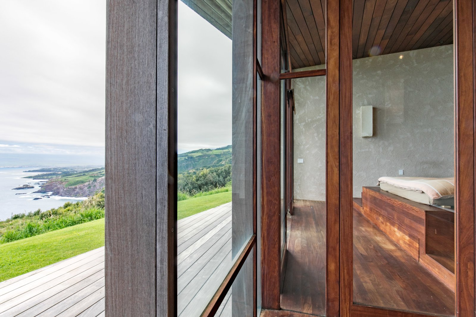Bedroom, Bed, Light Hardwood Floor, and Medium Hardwood Floor  The Clifftop House by Modern on Maui - Liam Ball