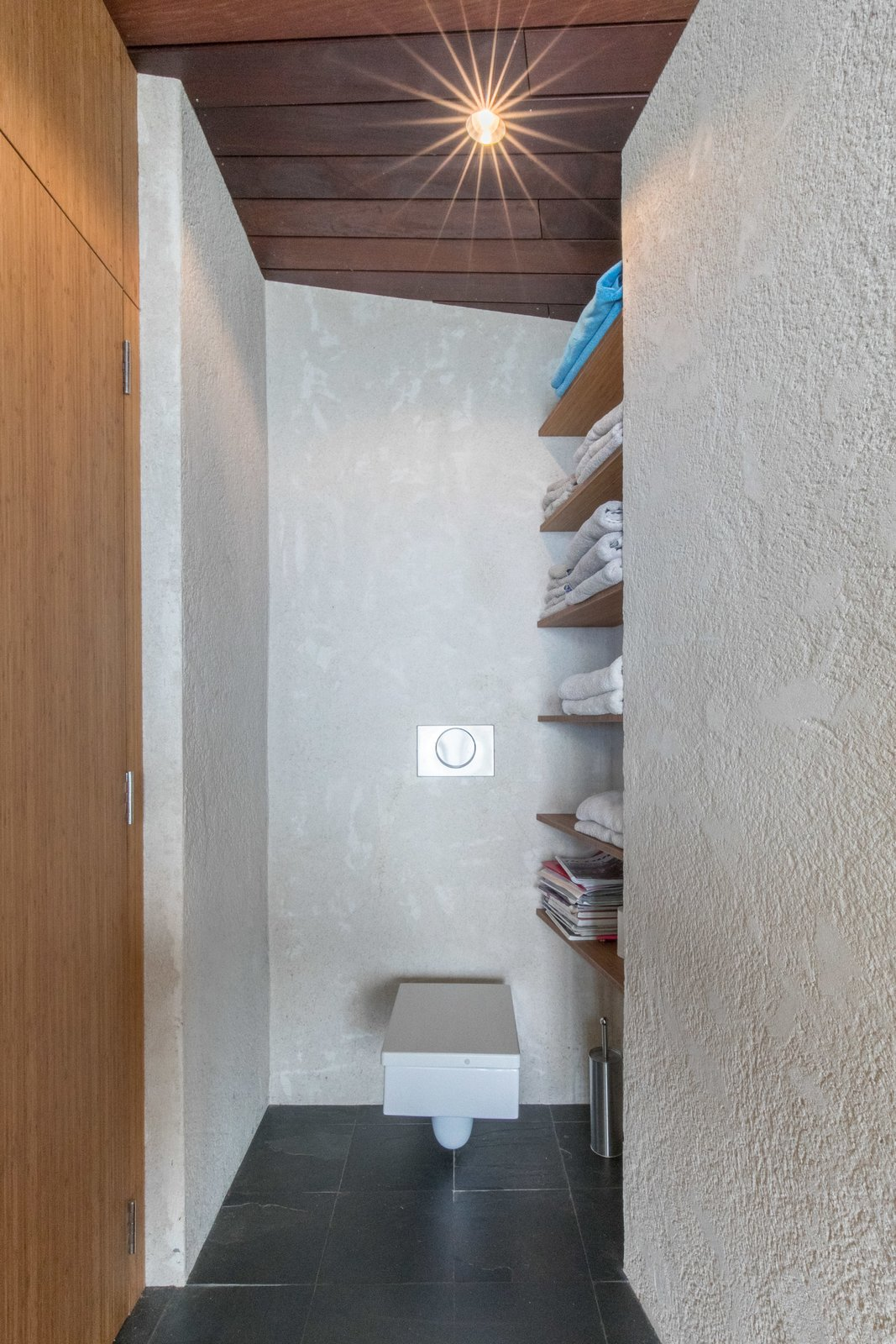 Bath Room, One Piece Toilet, and Accent Lighting  The Clifftop House by Modern on Maui - Liam Ball