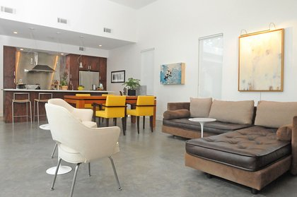 Living Room, Sectional, and Concrete Floor  Custer by TaC studios