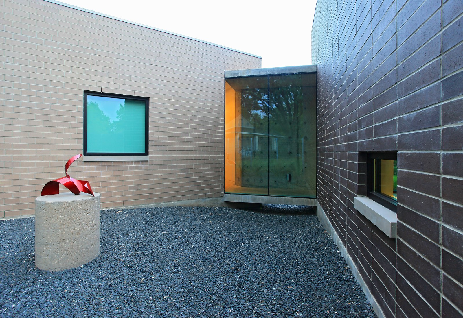 Exterior, Green Roof Material, Brick Siding Material, Glass Siding Material, and Flat RoofLine  Photos from Open House