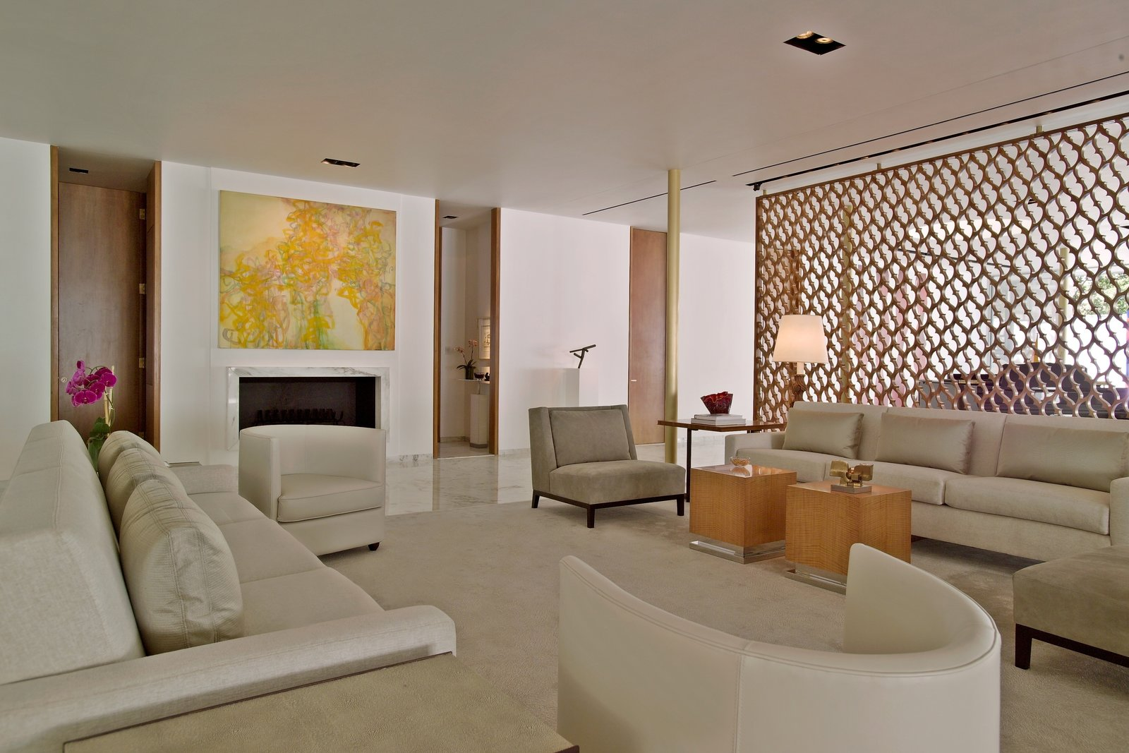 Living Room, Chair, Sofa, End Tables, Console Tables, Recessed Lighting, and Wood Burning Fireplace  Oak Court by buchanan architecture