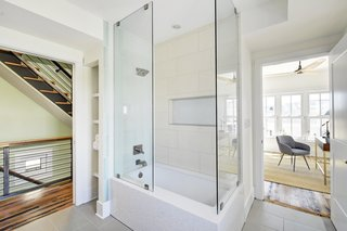 The second-floor bath is spacious and filled with natural light. It also benefits from dual-access entries to both the hallway and the adjacent bedroom.