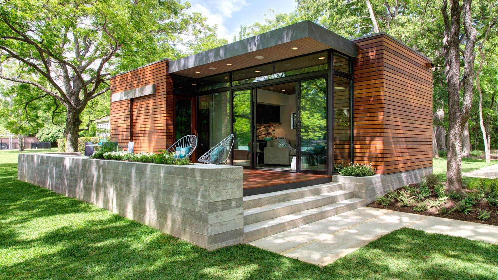 Exterior, Cabin Building Type, Wood Siding Material, and Glass Siding Material  Photo 14 of 21 in Dwell Community's Top 20 Homes of 2017 from Lake Austin Cabin