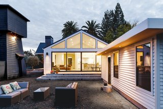 In Sonoma, California, a historic farmhouse receives a contemporary makeover. Large sliding doors allow for seamless indoor-outdoor connection.