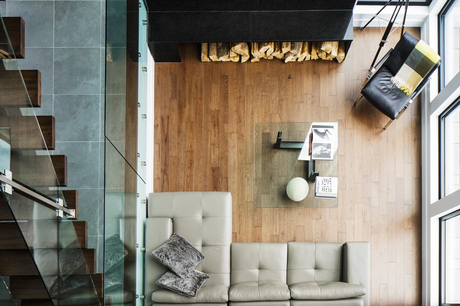 Living Room, Medium Hardwood Floor, Sectional, and Chair  Modern Lake Cabin by BONE Structure
