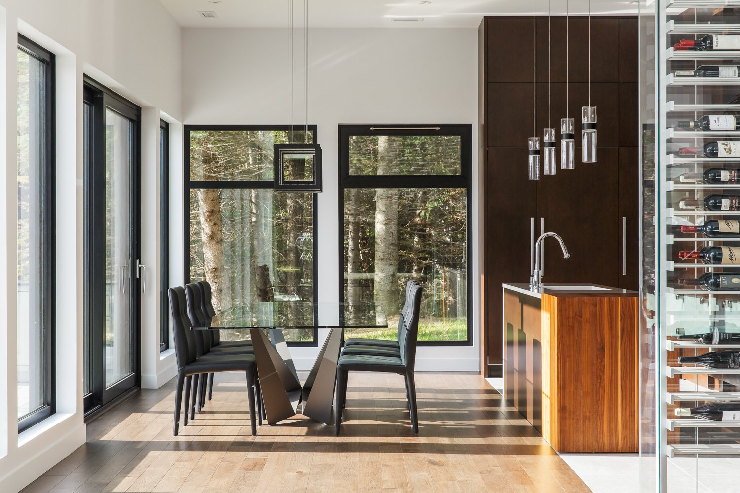 Dining Room, Table, Chair, Pendant Lighting, and Light Hardwood Floor  Modern Lake Cabin by BONE Structure
