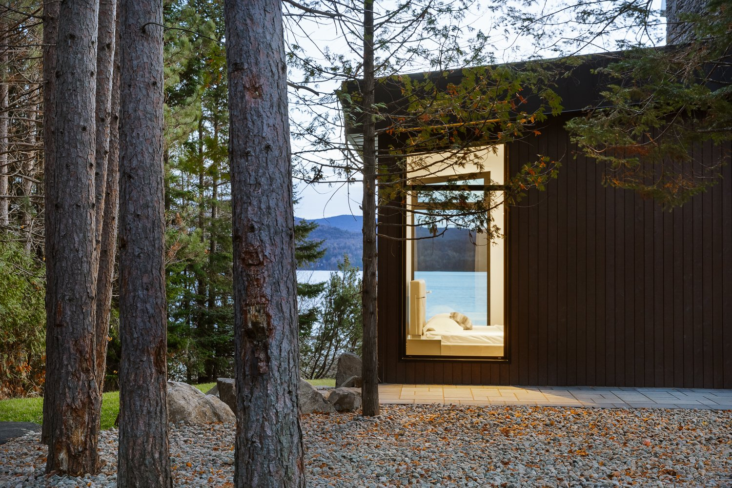 Exterior, Wood Siding Material, and House Building Type  Modern Lake Cabin by BONE Structure