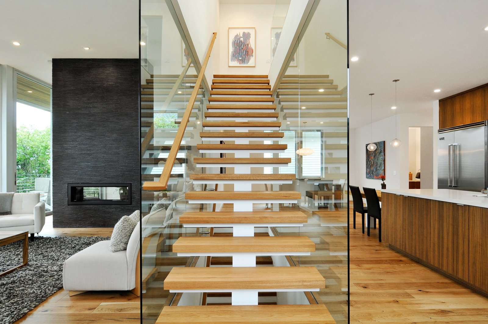 Staircase, Wood Tread, and Wood Railing  Acacia Residence by BONE Structure