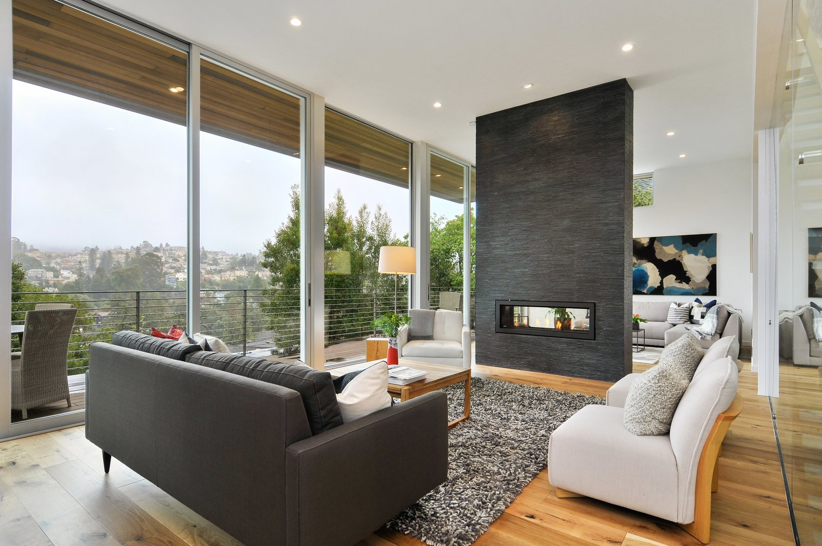 Living Room, Two-Sided Fireplace, and Sofa  Acacia Residence by BONE Structure