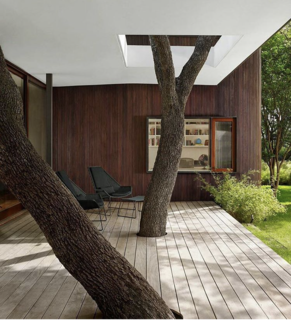 Mark Word Design incorporates trees directly into the deck and seating area at the Lakeview Residence in Austin, Texas.