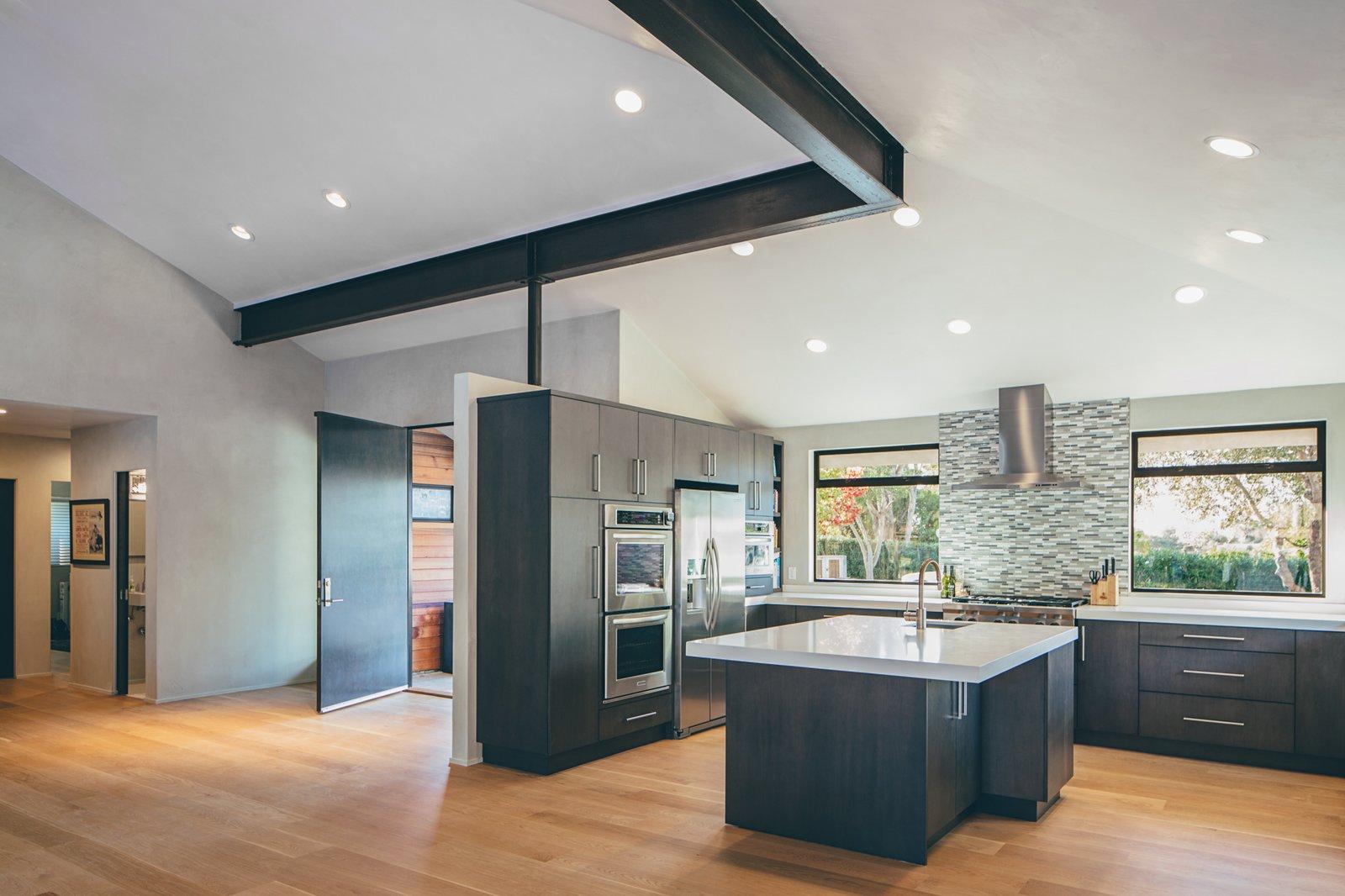 Kitchen, Medium Hardwood Floor, and Wood Cabinet  Crestline