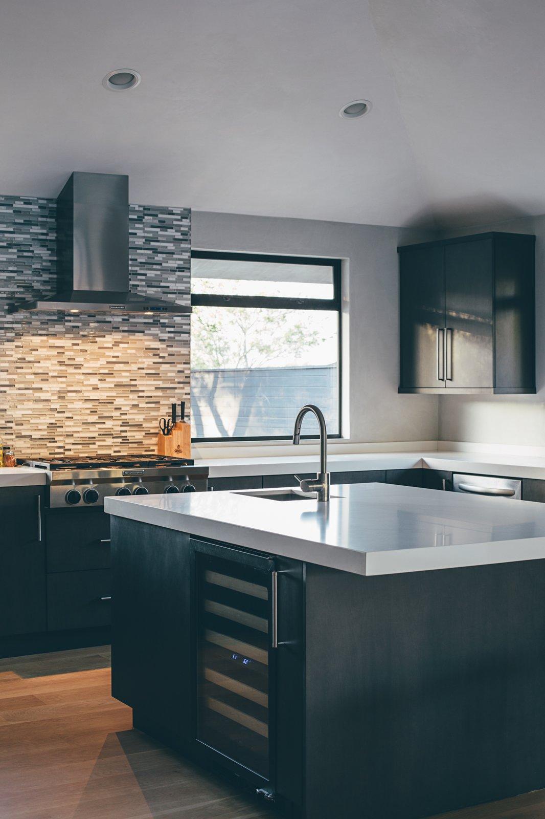 Kitchen, Concrete Counter, Medium Hardwood Floor, Recessed Lighting, Glass Tile Backsplashe, Undermount Sink, and Wine Cooler  Crestline