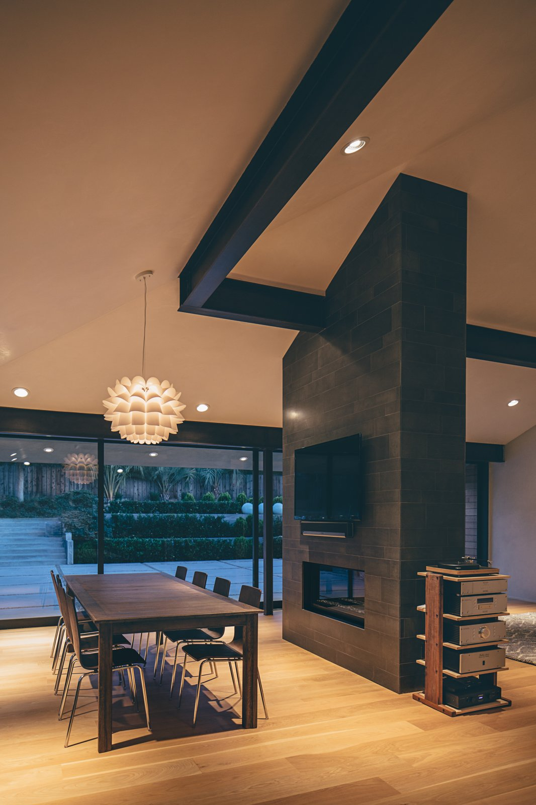 Dining Room, Chair, Medium Hardwood Floor, Table, Pendant Lighting, Two-Sided Fireplace, and Gas Burning Fireplace  Crestline