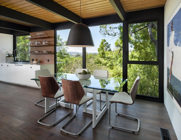 Dining Room, Pendant Lighting, Chair, Table, and Medium Hardwood Floor  Paseo Ferrelo
