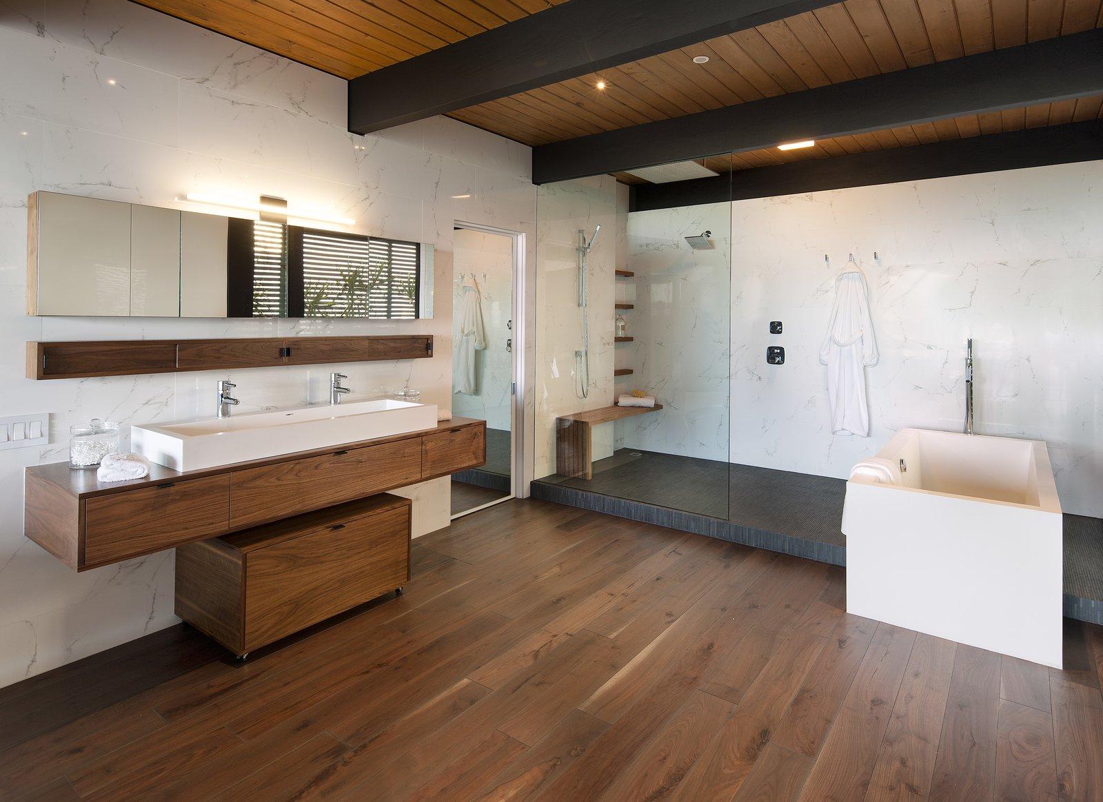 Bath Room, Vessel Sink, Wood Counter, Medium Hardwood Floor, Freestanding Tub, Open Shower, Corner Shower, Recessed Lighting, and Marble Wall  Paseo Ferrelo