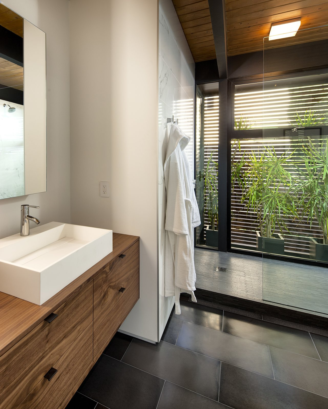 Bath Room, Wood Counter, Cement Tile Floor, Vessel Sink, Corner Shower, Ceiling Lighting, and Open Shower  Paseo Ferrelo