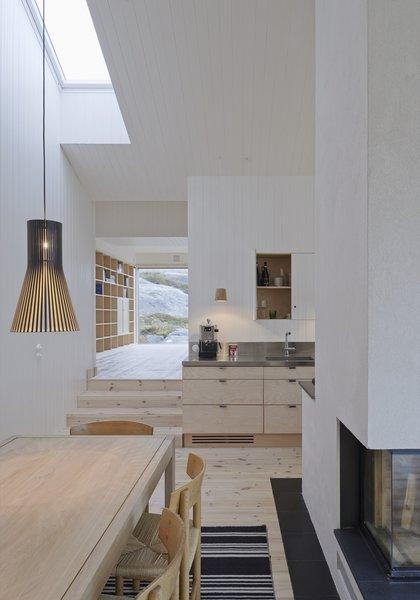 Kitchen, Wood Cabinet, Light Hardwood Floor, Pendant Lighting, and Metal Counter  Modern Danish Homes We Love from Naked Naust
