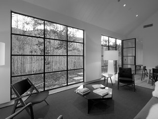 The big window and door in the living room provide a connection to the aspen trees outside.