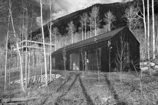 Cottage Black in nestled in the aspen grove below the main house.