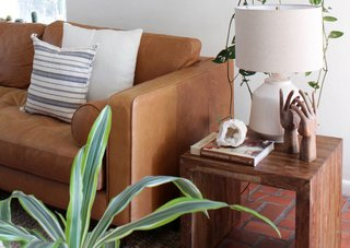 The warm tones of a cognac leather sofa ground a space with lots of color.