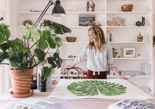 "Jenny describes white space as equally important to her work as her signature green plantlife. ""I'm all about white, negative space. It's just as important as a full page of colour,"" she says."