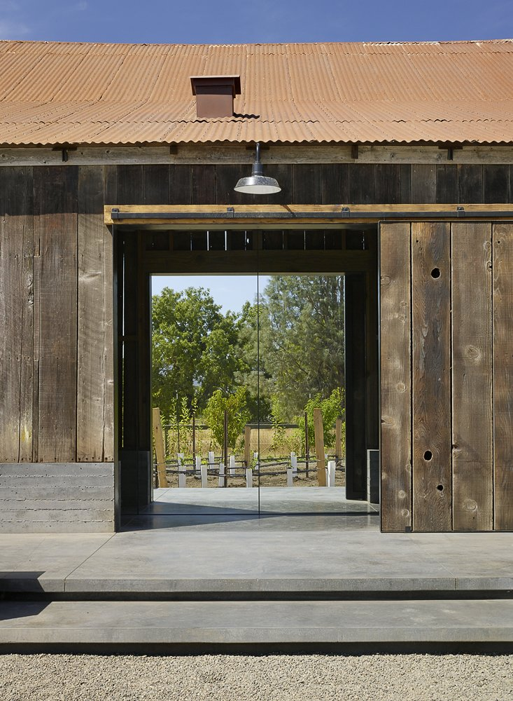 Outdoor, Hanging Lighting, and Back Yard  Napa Vineyard Barn by Centric General Contractors from Barn door styles for closet