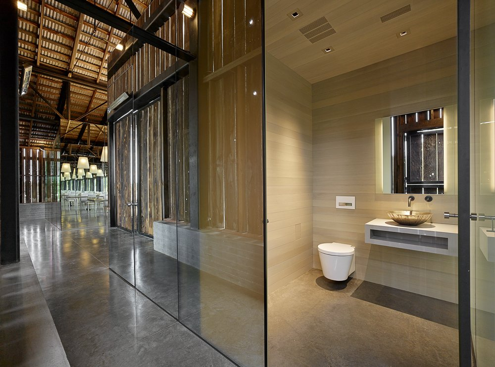 Bath Room, Stone Counter, Concrete Floor, Recessed Lighting, and One Piece Toilet  Napa Vineyard Barn by Centric General Contractors