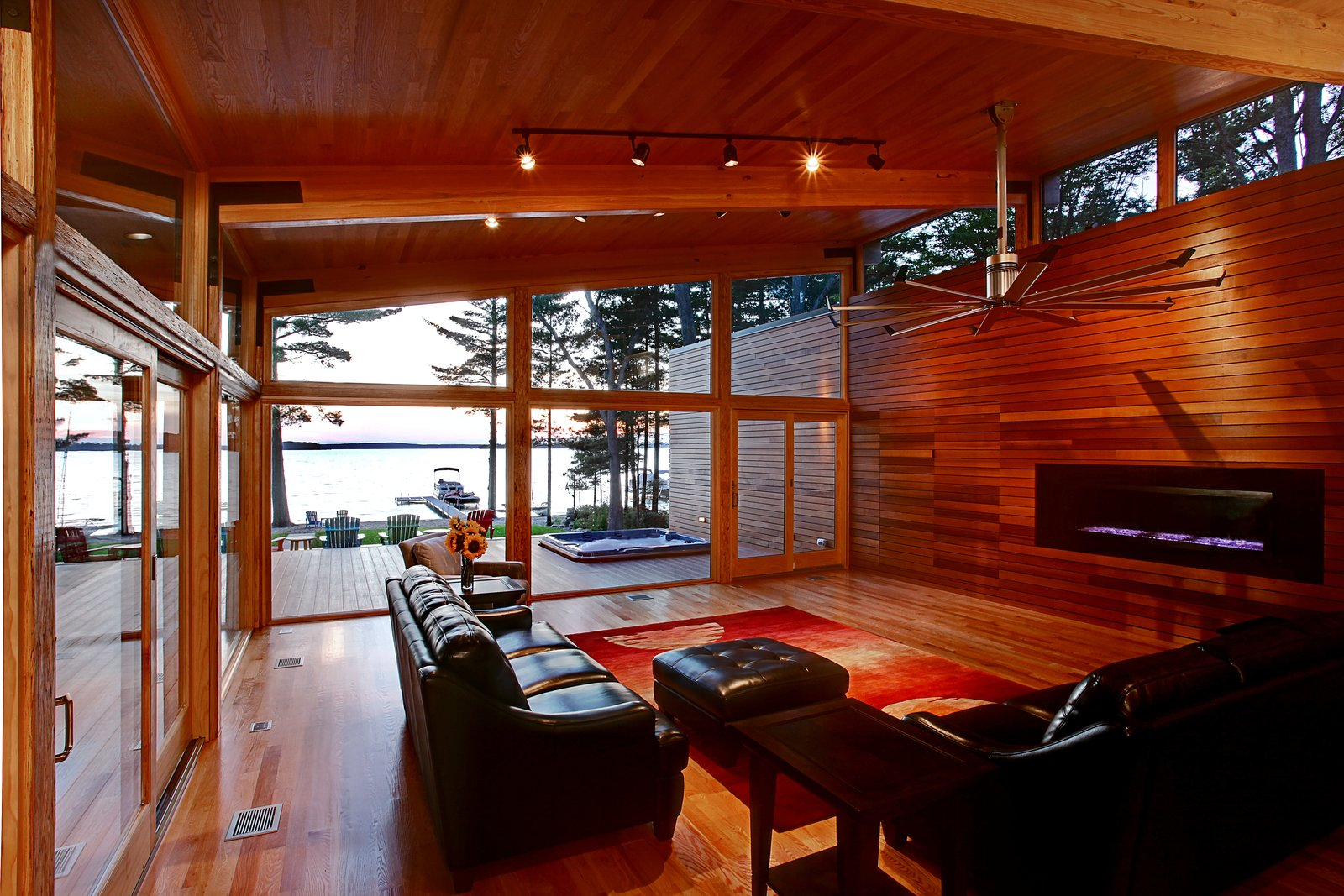 Living room looking out toward lake  Higgins Lake House by Jeff Jordan Architects