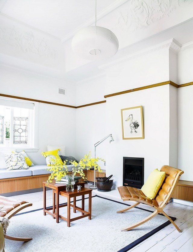 A light and lemony lounge space is the perfect place to soak up morning sunshine. Because lemon water in the morning is best enjoyed among tart yellow pillows and bright flowers in full bloom.  Photo by Maree Homer for Homes to Love  #chartreuse #colorcrush #color #yellow #design #mydomaine   Photo 4 of 13 in 15 Flower Arrangements That Will Brighten Your Home on Valentine's Day