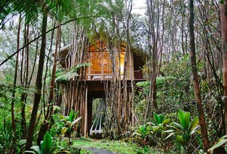 Just look at that dreamy canopy hammock suspending from the floor to the ground level. If you're in need of a slower pace, look no further than this island-jungle abode where bamboo abounds. And if you like the façade, wait until you get a peek inside of the chic interiors.
