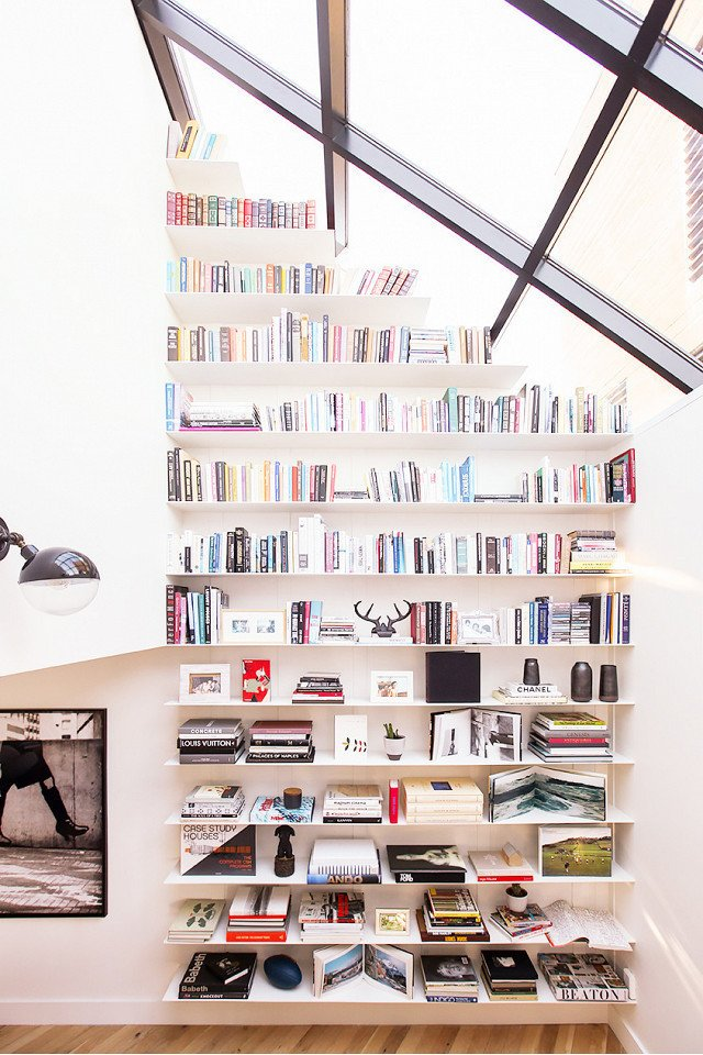 PHOTO: Shade Degges; DESIGN: Heather Heron  Photo 15 of 18 in 9 Home Libraries We All Want to Curl Up in This Weekend