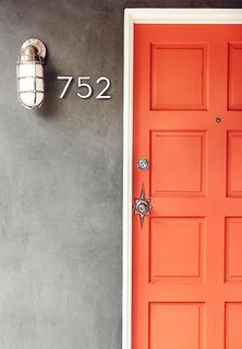 This front door should be all the proof you need to decide that when it comes to doors, orange is the new black. It might be brunch feelings talking, but the bright hue reminds me of a perfect blood-orange mimosa. Needless to say, I've personally got a little orange crush on this one.