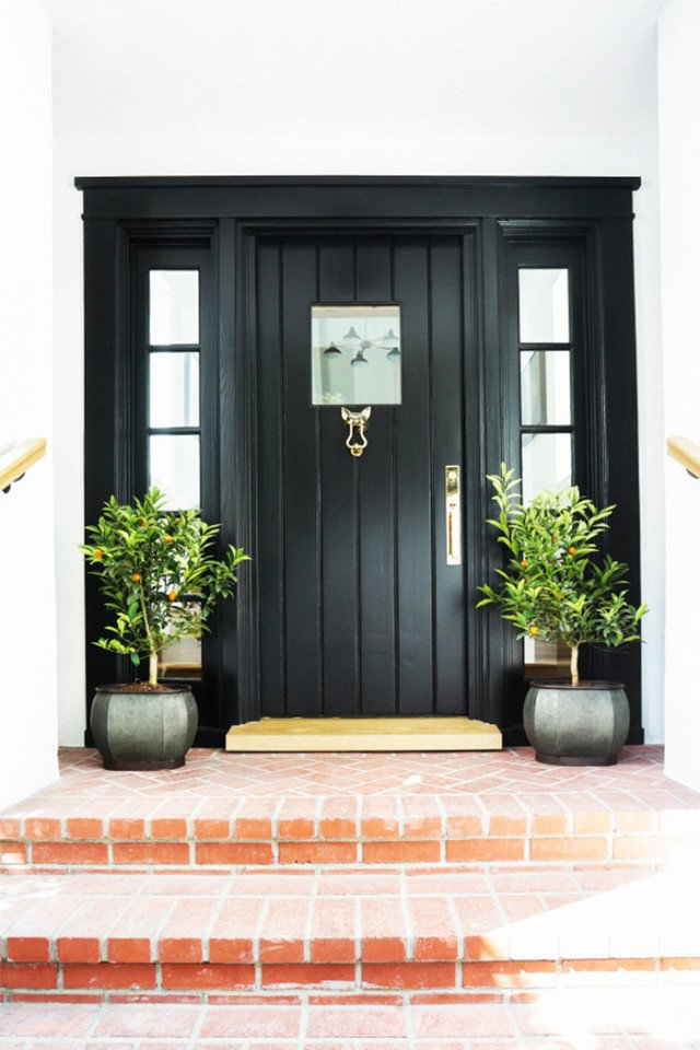 This is a door we adore. There's something so stylishly simple about a classic black door and frame that reminds us it's time to step up.  Photo 18 of 23 in What's the Best Color to Paint Your Front Door? Your Guide to Finding The One