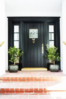 This is a door we adore. There's something so stylishly simple about a classic black door and frame that reminds us it's time to step up.