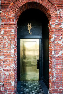 This metallic gold door shines bright to welcome guests to L.A.'s Hotel Covell. Against a backdrop of more textural, aged elements—like the brick wall—it's a smooth, glam touch.