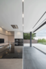 Modern home with Kitchen, Slate Floor, Wood Cabinet, Track Lighting, Ceiling Lighting, Cooktops, Microwave, Range, Concrete Floor, Wall Oven, Range Hood, and Undermount Sink. Photo 4 of ELL - A developers dream