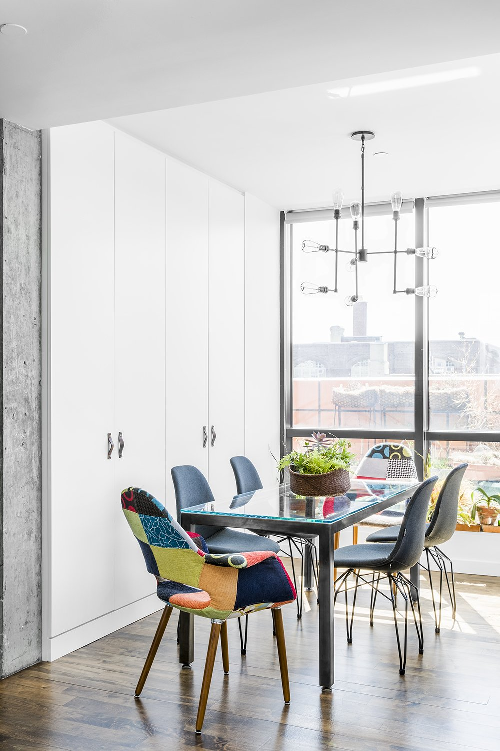 Dining Room, Chair, Table, and Pendant Lighting  Heavy Metal by James Wagman Architect