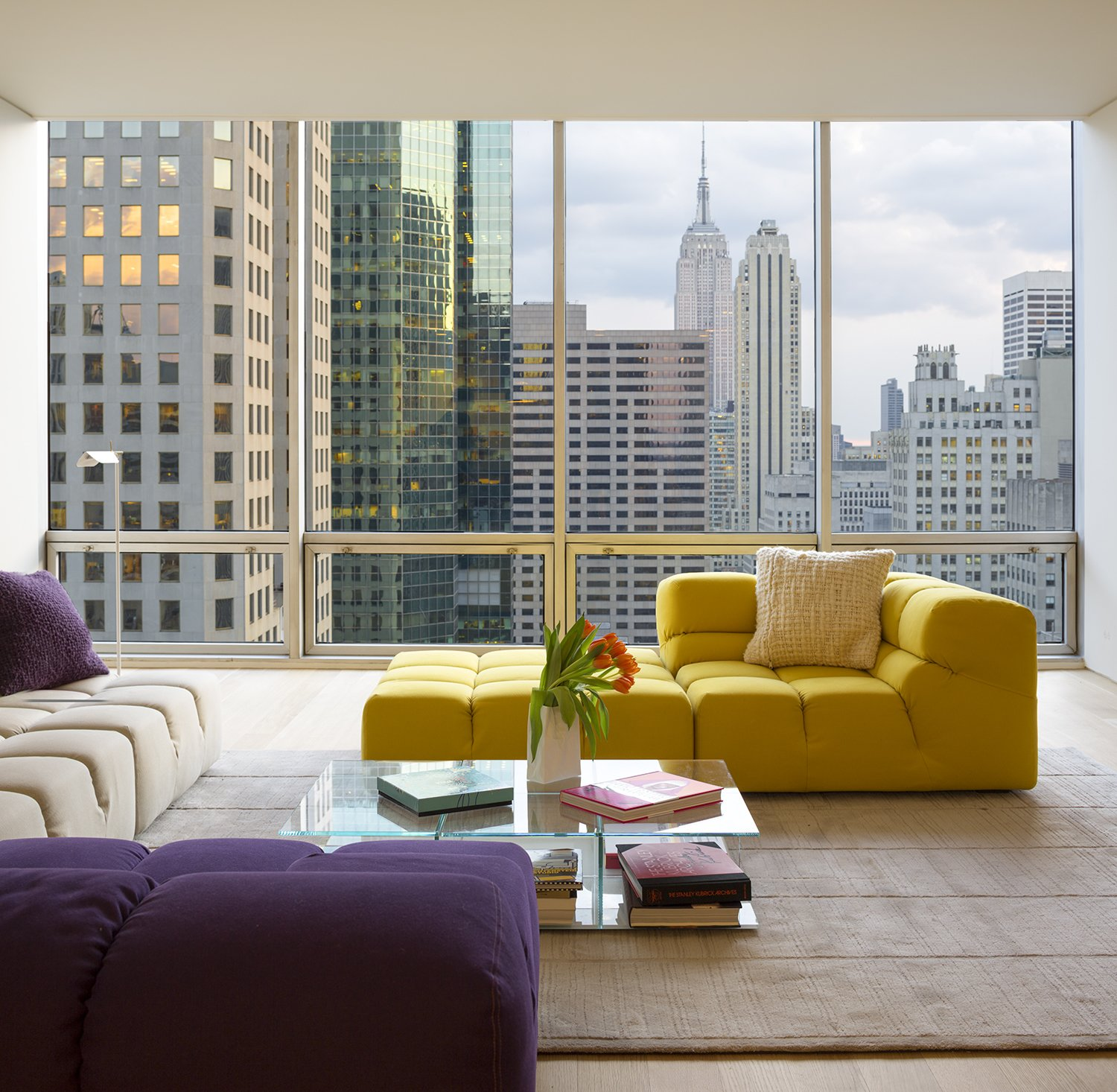 Tagged: Living Room, Sofa, and Coffee Tables.  A Pop of Color by James Wagman Architect
