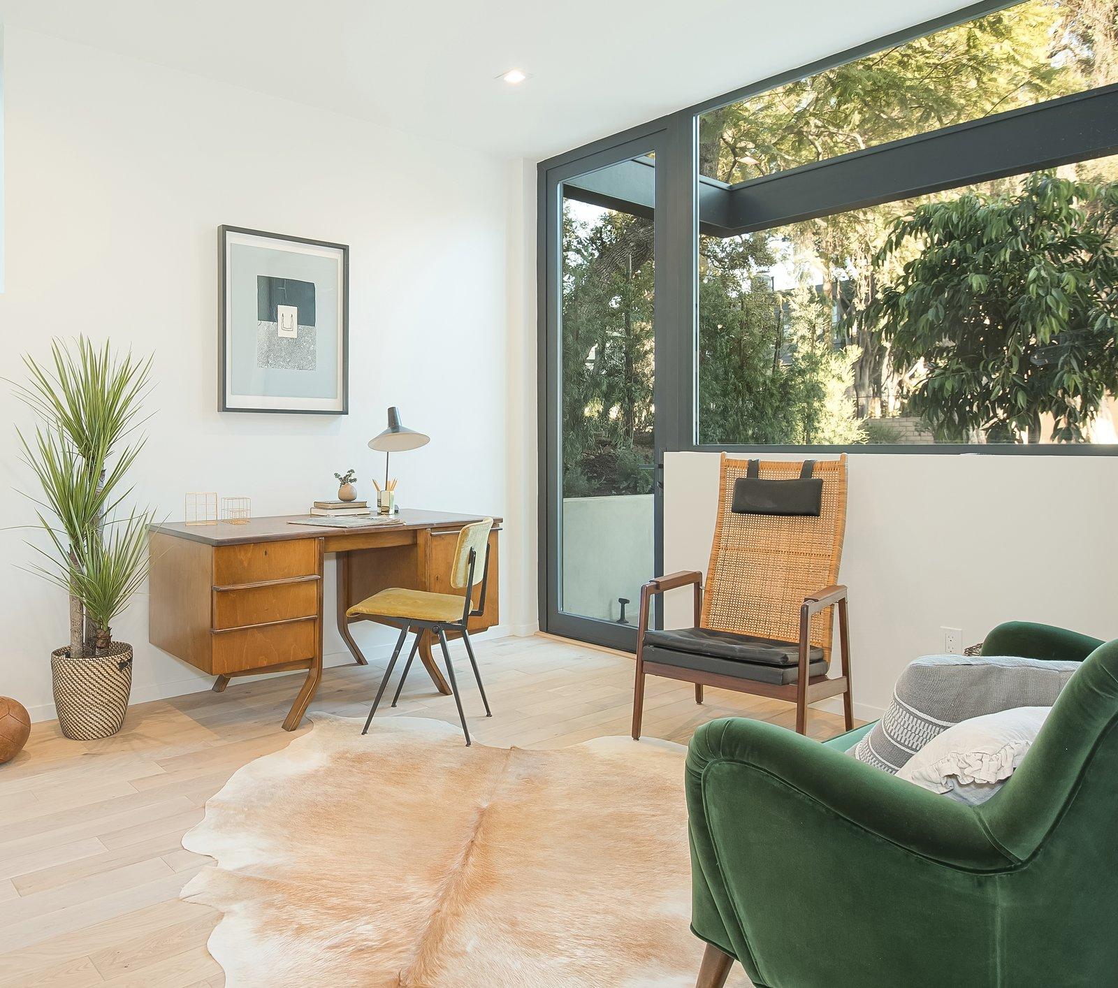 Office, Library Room Type, Medium Hardwood Floor, Chair, and Desk Den  SL House by ANX / Aaron Neubert Architects