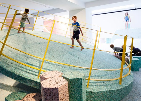 There's nothing brutal about the interior of this Brutalist-inspired playground in the Royal Institute of British Architects. Pastel foam replaces the cold cement shapes found vintage British Brutalist playgrounds. Its edgy, off-kilt, angles are balanced with the soft hues and materials. Together, this modern Brutalist Playground repackages the stern structures of the past into a sweet and palpable escape.  Photo 4 of 11 in 10 Playgrounds With Modern Twists