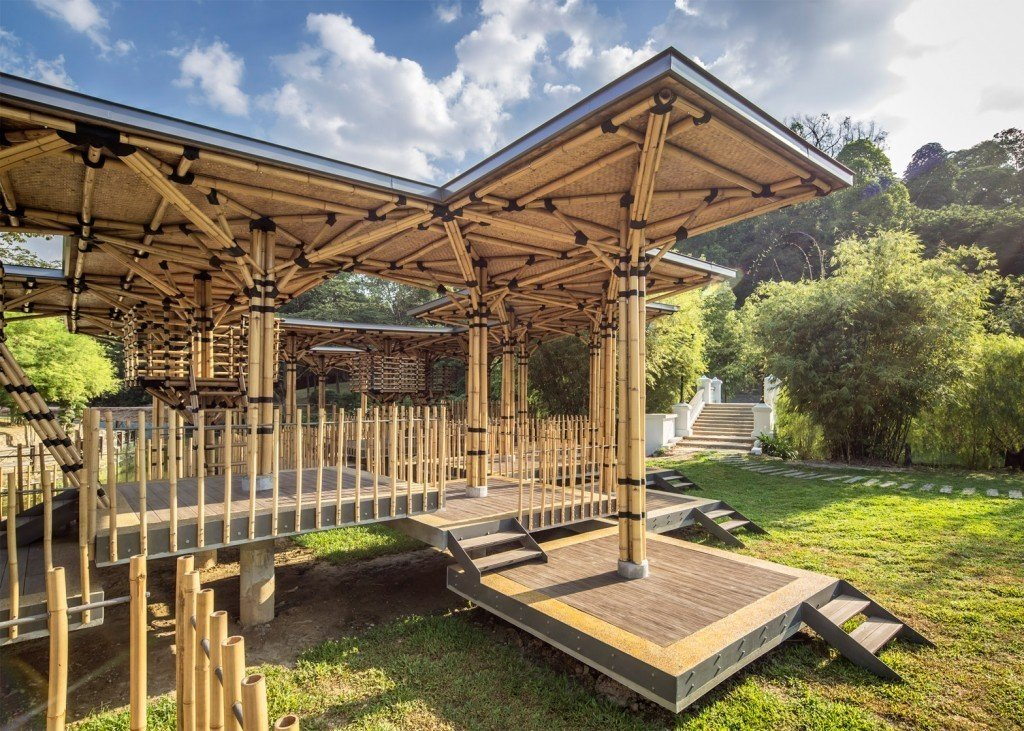 This island playhouse integrates with its tropical environment. The Bamboo Playhouse in Kuala Lumpur  is located in the middle of lush gardens and is constructed with traditional Malaysian techniques. Architect Eleena Jamil used traditional materials for a modern application. Bamboo serves as an extremely strong, ventilated and airy material to compose this 320-square meter space.  Photo 7 of 11 in 10 Playgrounds With Modern Twists