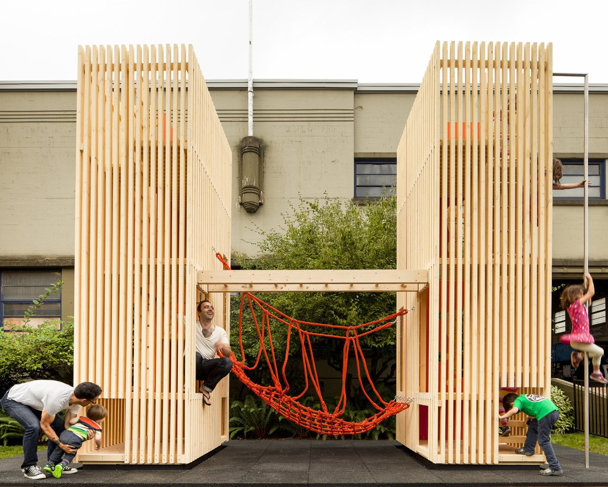 Sam + Pam is a compact playhouse with a minimal aesthetic. These two hollow pallet structures provide plenty of room for children to take turns crossing the rope bridge that join them. Even more impressive is its ability to fit in a 8 square feet space.  Photo 8 of 11 in 10 Playgrounds With Modern Twists