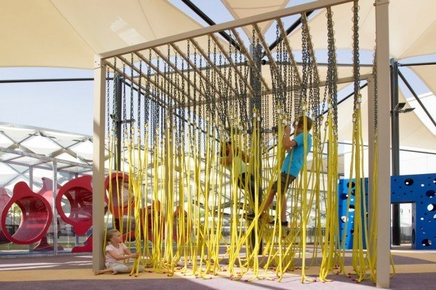 This Abu Dhabi playground compartmentalizes the senses within each interactive unit. This four-part playground is located in the popular and exquisite Hazza Bin Zayed Stadium. People of all ages are encouraged to swing, crawl, feel their way through each shaded experience.  Photo 9 of 11 in 10 Playgrounds With Modern Twists