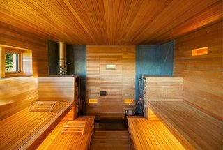 Designed by Andre Tchelistcheff Architects, this sauna glows in the sunny rolling hills of upstate New York.