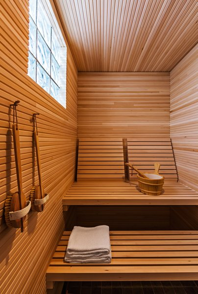 Naturally sleek, this wooden sauna by Salmela Architect is both simple and honest.  Photo 4 of 10 in 10 Sterling Saunas in Modern Homes