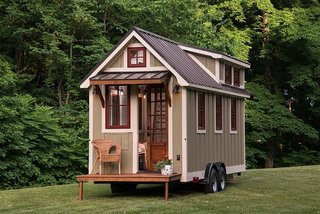 This tiny mobile house by Timbercraft Tiny Homes is only 150 square feet.