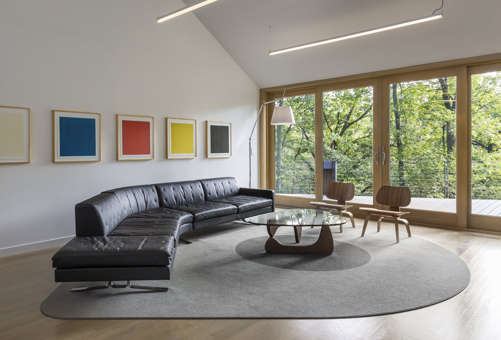 Living Room, Rug Floor, Sectional, Light Hardwood Floor, Chair, and Coffee Tables  3LP Residence by Substance Architecture