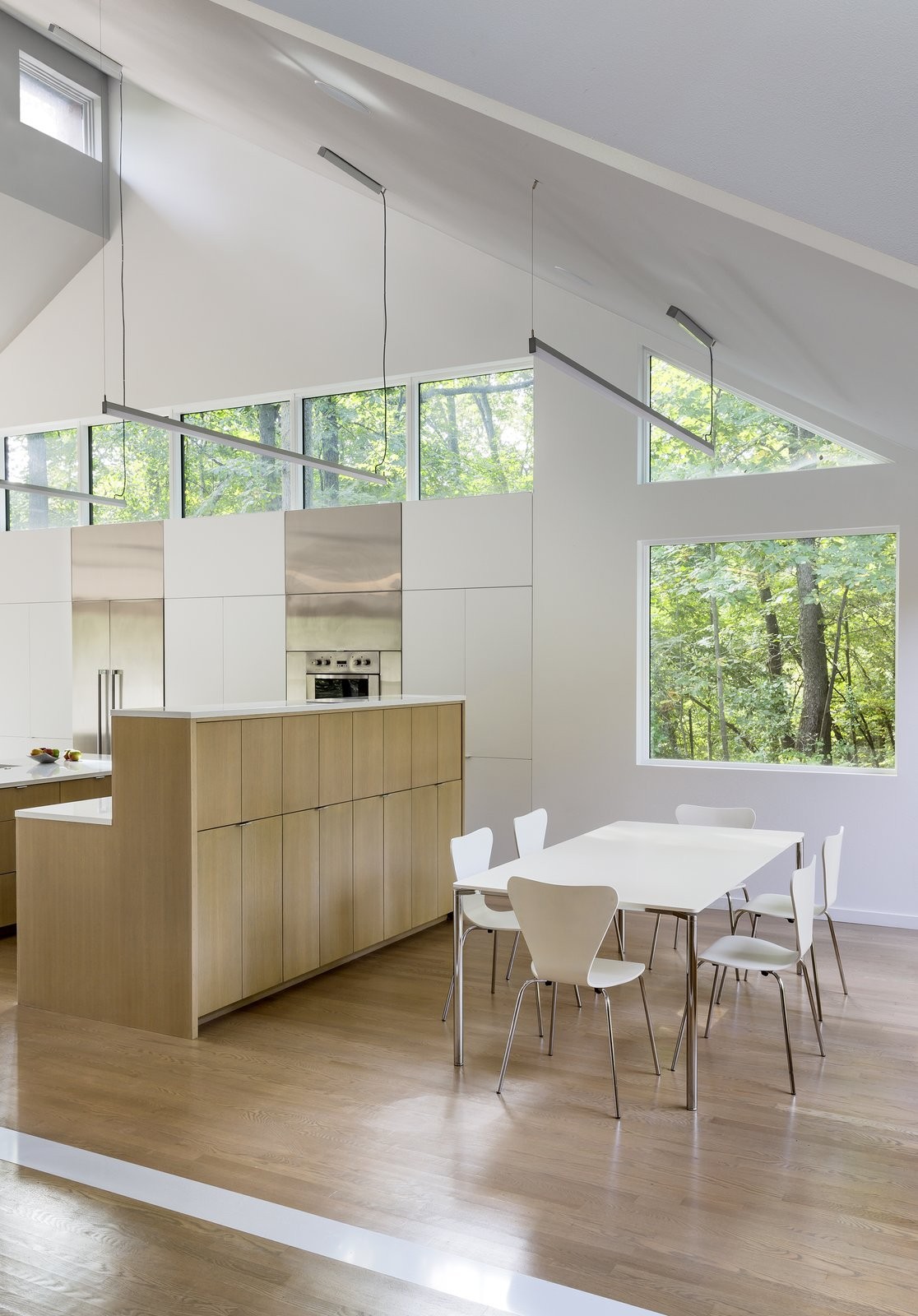 Dining Room, Table, Chair, and Light Hardwood Floor  3LP Residence by Substance Architecture