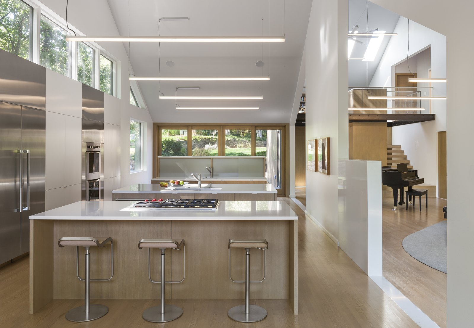 Kitchen, Light Hardwood Floor, White Cabinet, and Refrigerator  3LP Residence by Substance Architecture